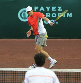 Bob Bryan returns the ball as he plays doubles with his brother, Mike (not in the photo) against Oliver Marach and Andre Sa, during the first round of the US Men's Clay Court Championships, Wednesday, April 10, 2013, in Houston. Photo: Karen Warren, Houston Chronicle / © 2013 Houston Chronicle