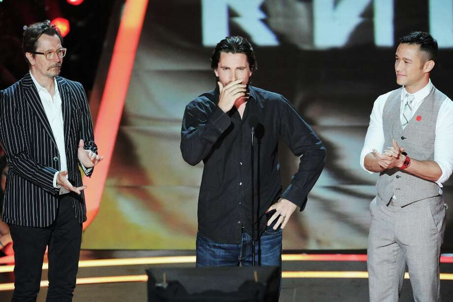 "Christian Bale, seen here with Gary Oldman and Joseph Gordon-Levitt, gets emotional after seeing his ""Batman"" co-star Heath Ledger in a ""Batman"" montage at the 2012 MTV Movie Awards at Gibson Amphitheatre on June 3, 2012 in Universal City, California.  (Photo by Jeff Kravitz/FilmMagic) Photo: Jeff Kravitz, FilmMagic / 2012 Jeff Kravitz"