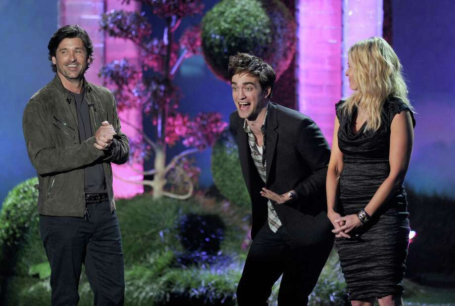 Actor Robert Pattinson had a rollicking time at the 2011 awards. Here he's presenting an award to Reese Witherspoon with Patrick Dempsey and Chelsea Handler speak onstage He dropped the 'f-bomb' during the speech. Photo: Kevin Winter, Getty Images / 2011 Getty Images