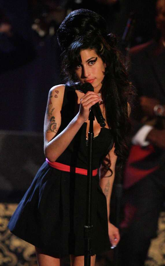 "Singer Amy Winehouse performs ""Rehab"" onstage during the 2007 MTV Movie Awards held at the Gibson Amphitheatre on June 3, 2007 in Universal City, California. Photo: Kevin Winter, Getty Images / 2007 Getty Images"