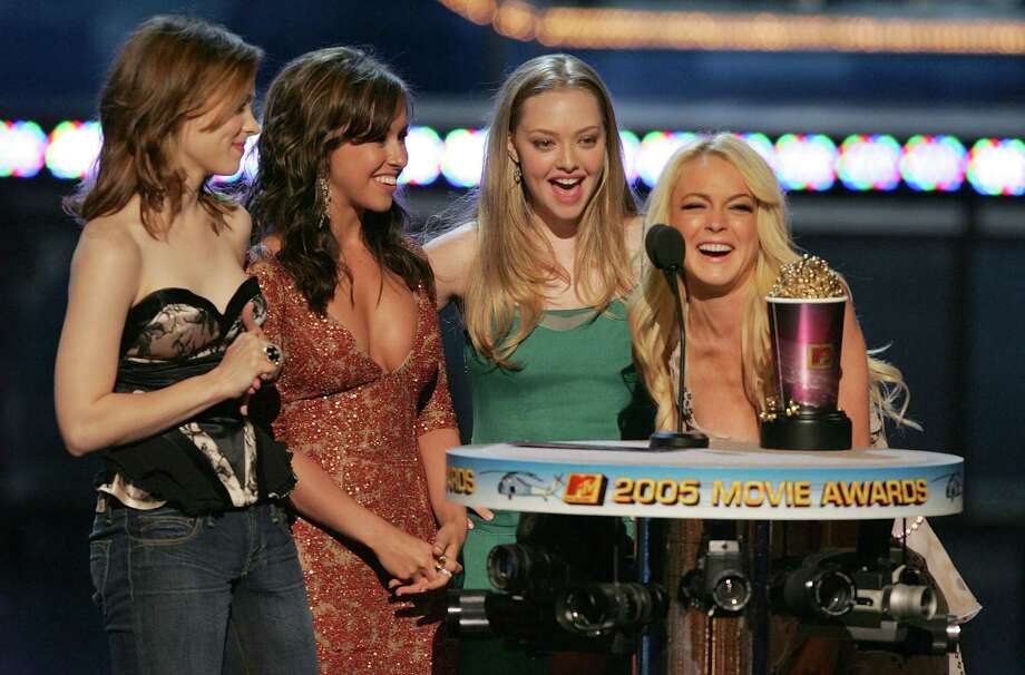 "The ""Mean Girls"": Actresses Rachel McAdams, Lacey Chabert, Amanda Seyfried, and Lindsay Lohan accept their award for Best Team onstage during the 2005 MTV Movie Awards at the Shrine Auditorium on June 4, 2005 in Los Angeles, California. Photo: Kevin Winter, Getty Images / 2005 Getty Images"