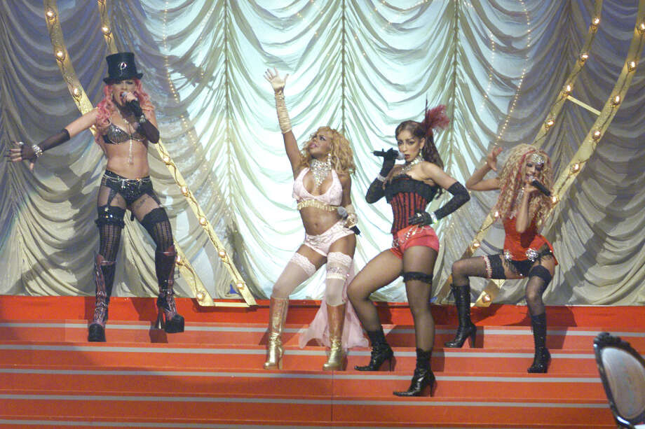 Pink, Lil' Kim, Mya and Christina Aguilera perform 'Lady Marmalade' from 'Moulin Rouge' at the 2001 MTV Movie Awards at the Shrine Auditorium in Los Angeles Saturday, June 2, 2001. Photo: Kevin Winter, Getty Images / Getty Images North America