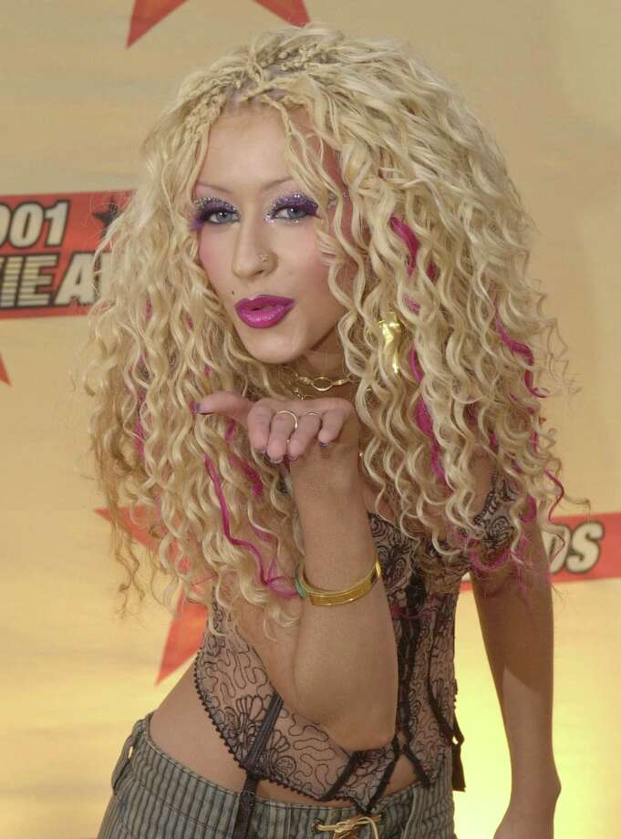 Singer Christina Aguilera and her hair arrive at the 2001 MTV Movie Awards June 2, 2001 at the Shrine Auditorium in Los Angeles, CA. Photo: Chris Weeks, Getty Images / Getty Images