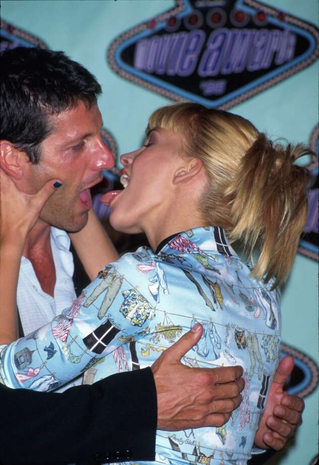 "Actors Anthony Guidera and Natasha Henstridge demonstrating their award-winning Best Kiss from their film ""Species"" in Press Room at MTV Movie Awards in 1996 (Photo by Mirek Towski/Time & Life Pictures/Getty Images) Photo: Mirek Towski, Time Life Pictures/Getty Images / Time & Life Pictures"