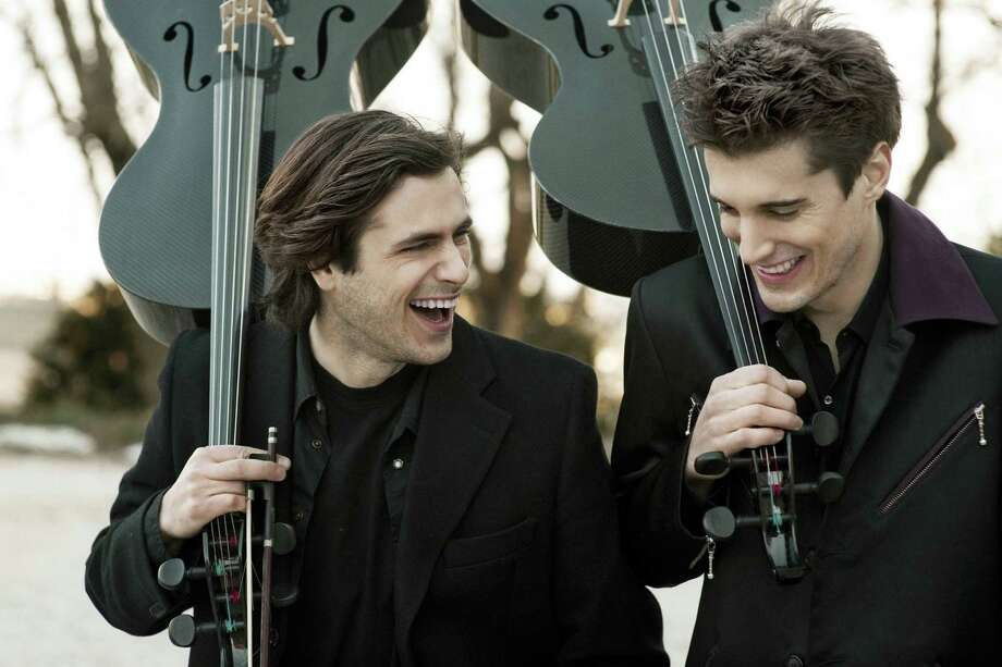 "Cellists Stjepan Hauser (left) and Luka Sulic of 2Cellos got the music world's attention with a music video rendition of Michael Jackson's ""Smooth Criminal."" Photo: Courtesy Photo"