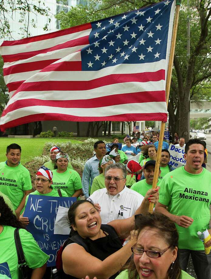 Hundreds of protesters marched along Smith St. to call on Texas Senator Ted Cruz to support immigration reform with a clear path to citizenship. Photo: J. Patric Schneider, For The Chronicle / © 2013 Houston Chronicle