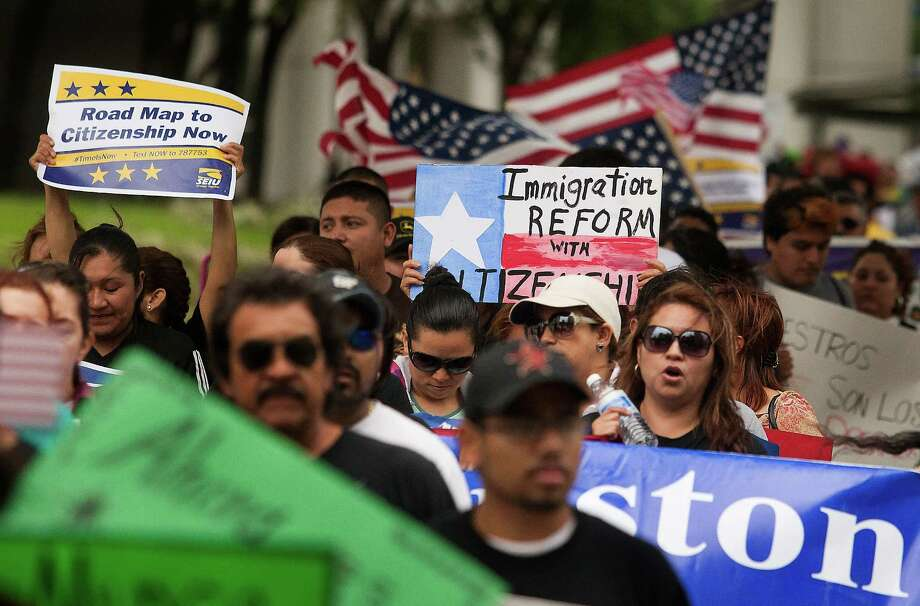 Hundreds of protesters marched along Smith St. to call on Texas Senator Ted Cruz to support immigration reform with a clear path to citizenship on Wednesday, April 10, 2013, in Houston. Photo: J. Patric Schneider, For The Chronicle / © 2013 Houston Chronicle