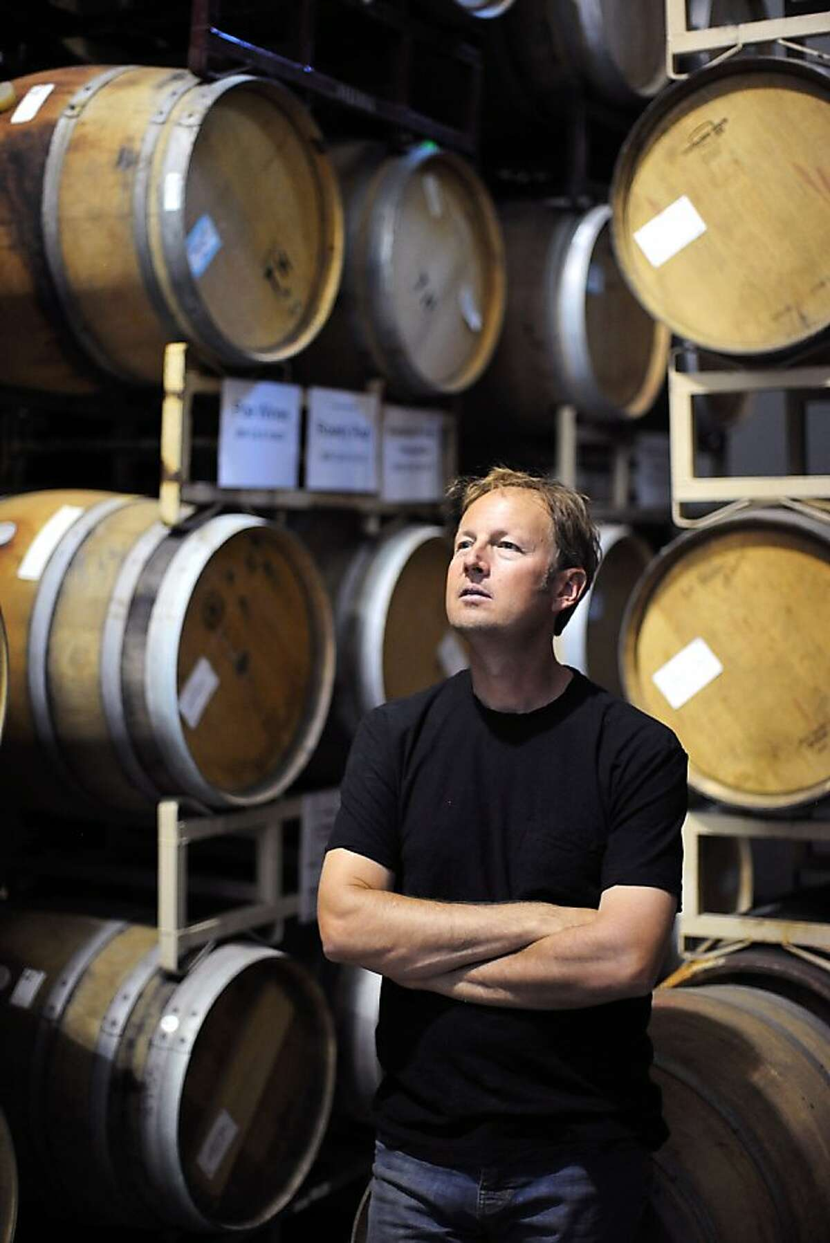 Steve Matthiasson looks around the barrel room at Silenus Vintners, a where he produces his wine after harvest, in Napa, CA Wednesday April 10th, 2013.