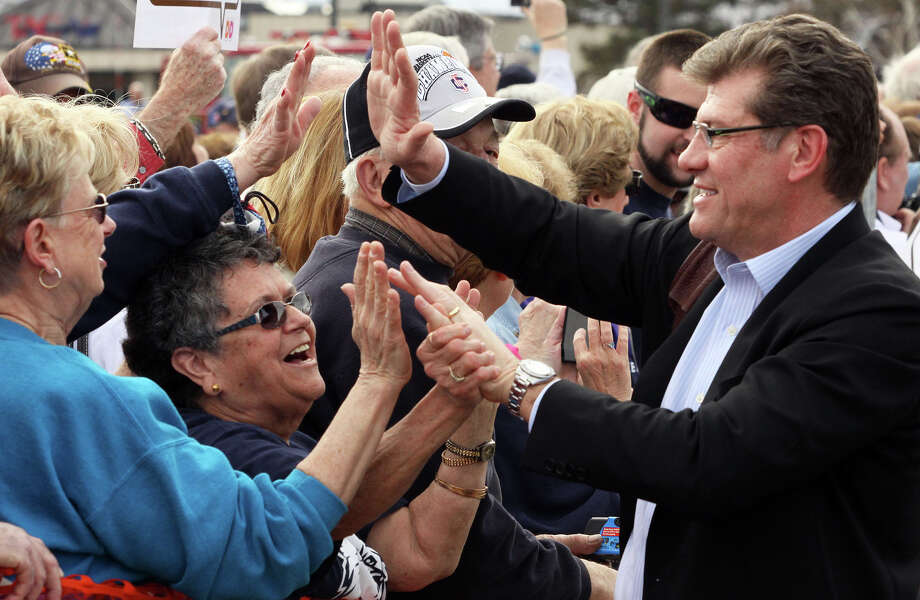 Connecticut women's basketball head coach Geno Auriemma greets fans Wednesday April 10, 2013, at the welcome home celebration at Bradley International Airport in Windsor Locks Conn. The team defeated Louisville to win the women's NCAA Final Four college basketball championship. (AP Photo/Journal Inquirer, Jared Ramsdell) , Photo: Jared Ramsdell, Associated Press / Journal Inquirer