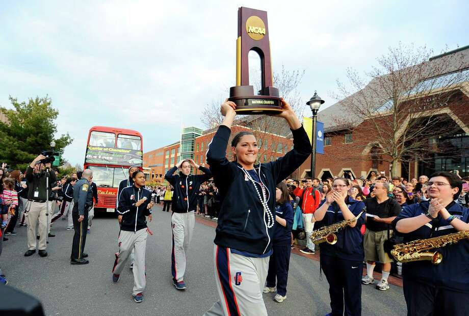 Connecticut's Stefanie Dolson carries the trophy during a parade through campus honoring the team's win in the women's NCAA Final Four college basketball championship in Storrs, Conn., Wednesday, April 10, 2013. (AP Photo/Jessica Hill) Photo: Jessica Hill, Associated Press / FR125654 AP