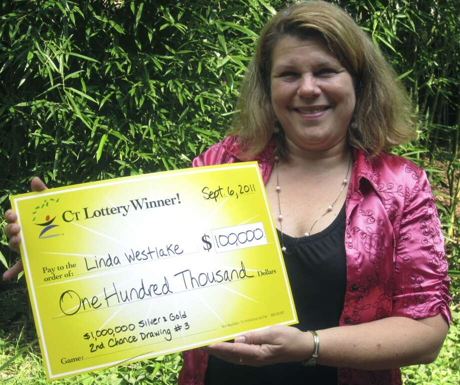 """New Milford has sold eight lottery tickets with payout of at least $10,000, for a total amount of $270,000 from the big tickets.  Linda Westgate, self-described as \""""Lucky Linda,\"""" shows off the certificate representing the $100,000 she just won via the Connecticut Lottery. September 2011"""
