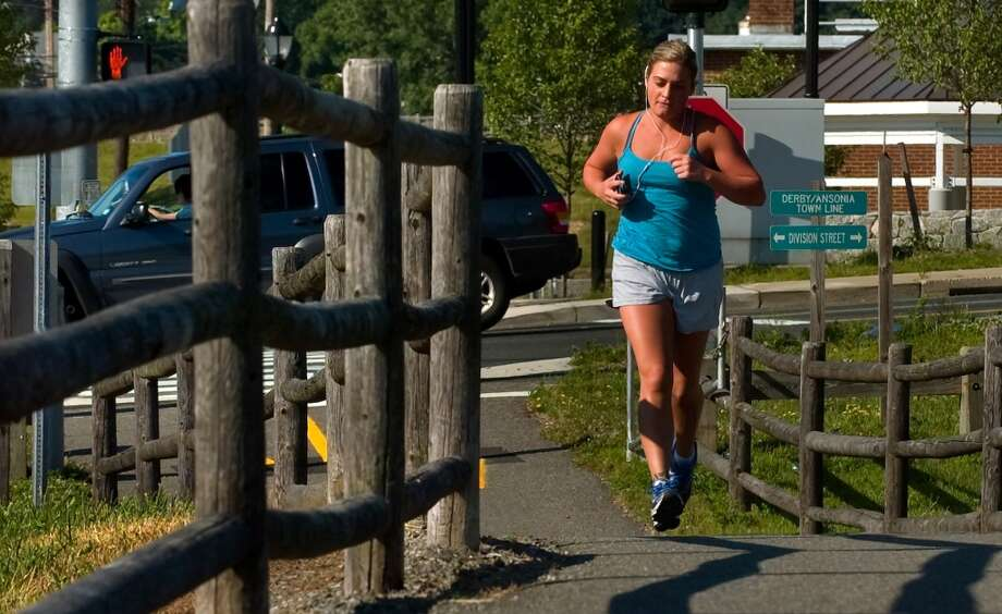 Derby has sold nine lottery tickets with payout of at least $10,000, for a total amount of more than $2.7 million from the big tickets.  Julie Mastrianni, of Derby, jogs along a portion of the Naugatuck River Greenway in Derby, Conn. on Thursday June 28, 2012.