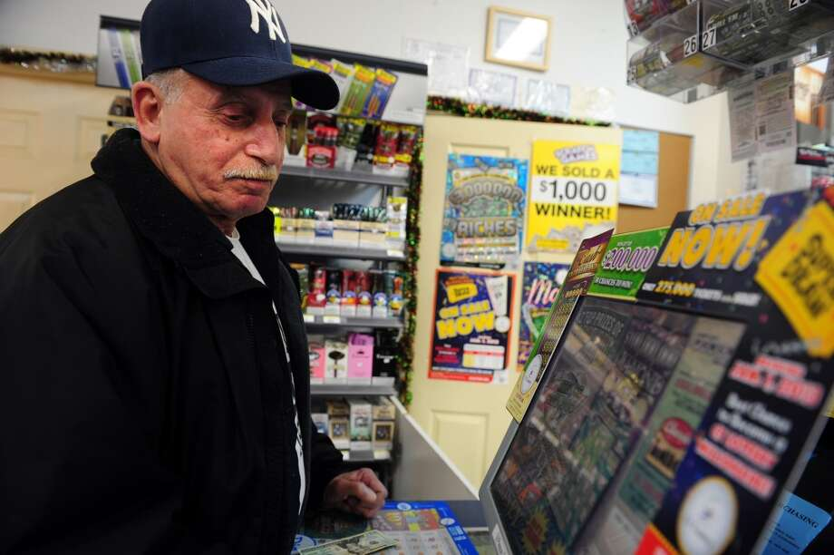 Shelton has sold 10 lottery tickets paying out $10,000 or more, for a total payout of $160,000 among those big-winning tickets.  John Sibilio, of Shelton, purchases his daily lottery tickets Tuesday, Nov. 27, 2012 at the BP gas station in Shelton, Conn. Wednesday\'s Powerball has a jackpot of $500 million.