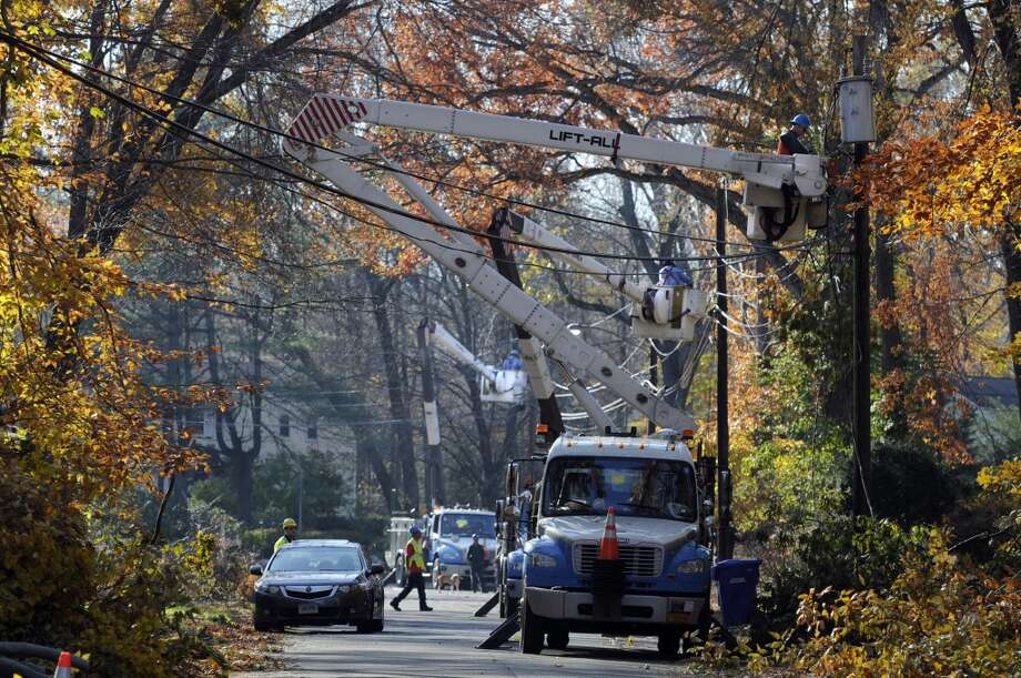 Bloomfieldhas sold 12 lottery tickets with payout of at least $10,000, for a total amount of more than $2.3 million from the big tickets.  Linemen from Brooklyn, New York work to restore power to customers on Cliffmount Drive in Bloomfield, Conn. on Tuesday Nov. 8, 2011. The neighborhood was heavily damaged by fallen trees and branches and is one of the few remaining areas in Bloomfield yet to have power.