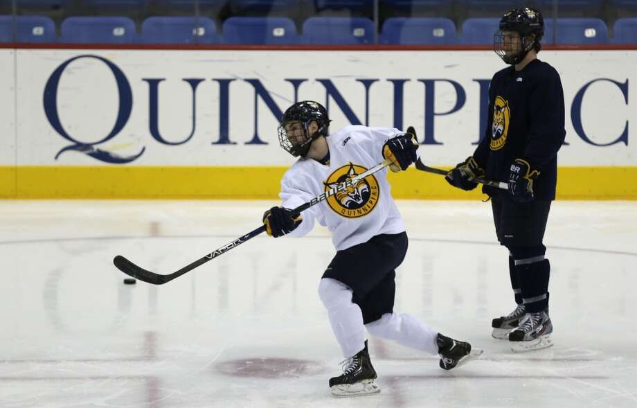Hamdenhas sold 18 lottery tickets with payout of at least $10,000, for a total amount of more than $1.5 million from the big tickets.  Quinnipiac forward Jeremy Langelois, left, shoots during an optional practice at the university in Hamden, Conn., Tuesday, April 2, 2013. Quinnipiac will face North Dakota in a national semifinal at the NCAA hockey Frozen Four.  At right is forward Clay Harvey. (AP Photo/Charles Krupa)