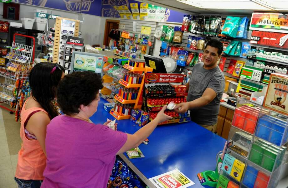 Seymourhas sold 19 lottery tickets with payout of at least $10,000, for a total amount of more than $60 million from the big tickets.  Shop Smart Store Manager Yaser Butt sells a lottery ticket to Teresa Ramos, of Seymour, in Seymour, Conn. on Wednesday July 11, 2012. A local Seymour couple has won the lottery and bought their ticket ffrom a local deli. Shop Smart has sold a winning lottery ticket in the past.