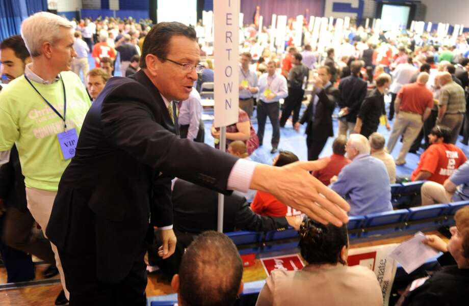 New Britain has sold 25 lottery tickets with payout of at least $10,000, for a total amount of more than $6.4 million from the big tickets.  Gov. Dannel P. Malloy shakes hands during the Democratic State Convention at Central Connecticut State University\'s Kaiser Hall in New Britain Saturday, May 12, 2012.