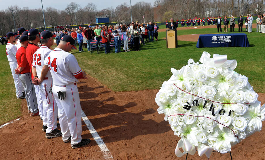 A ceremony to rename Foran High's baseball field in honor of the late former coach Ken Walker was held before Wednesday's game against Jonathan Law in Milford, Conn. on  April 10, 2013. Photo: Christian Abraham / Connecticut Post