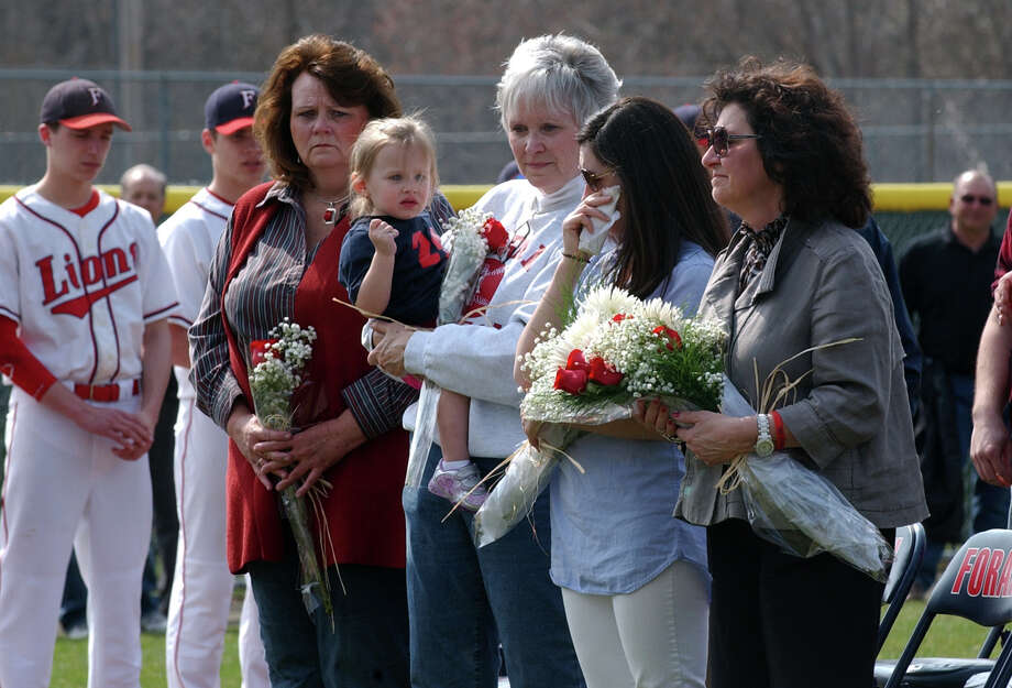 Members of the Walker family attend a ceremony to rename Foran High's baseball field in honor of the late former coach Ken Walker was held before Wednesday's game against Jonathan Law in Milford, Conn. on Wednesday April 10, 2013. Photo: Christian Abraham / Connecticut Post