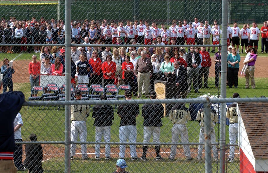 A ceremony to rename Foran High's baseball field in honor of the late former coach Ken Walker was held before Wednesday's game Jonathan Law in Milford, Conn. on Wednesday April 10, 2013. Photo: Christian Abraham / Connecticut Post