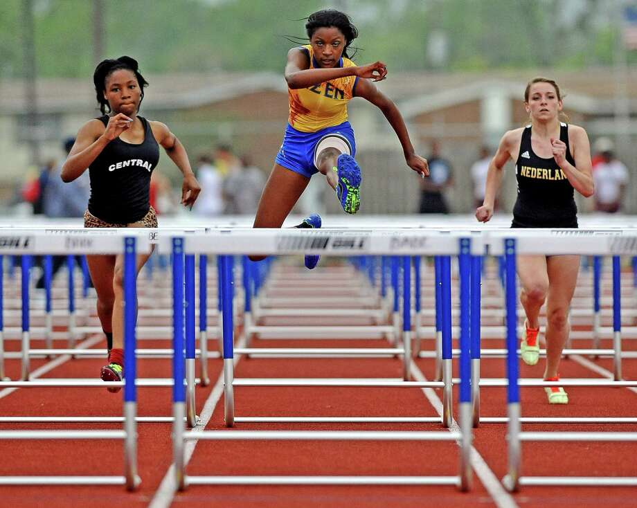 Ozen student Dominique Brannon, center, competes in the girls 100 meter hurdles at the UIL district 20-4A track and field championship on Wednesday, April 10, 2013, at Babe Zaharias Stadium. Photo taken: Randy Edwards/The Enterprise Photo: Randy Edwards