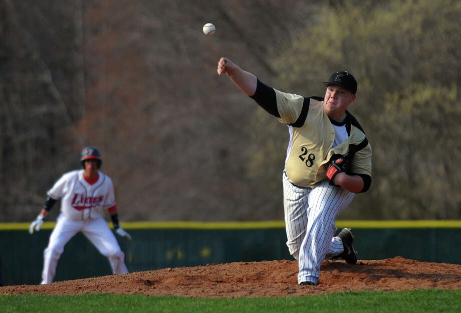 Jonathan Law's Kevin Johnson pitches against Foran, during baseball action in Milford, Conn. on  April 10, 2013. Photo: Christian Abraham / Connecticut Post