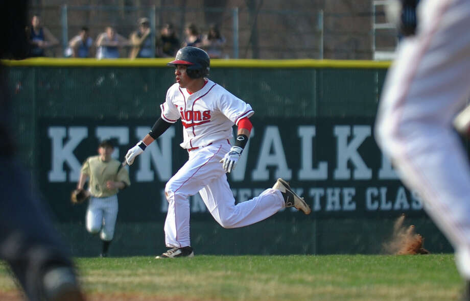 Foran's Reinaldo Jackson sprints to thind, during baseball action against Jonathan Law in Milford, Conn. on  April 10, 2013. Photo: Christian Abraham / Connecticut Post