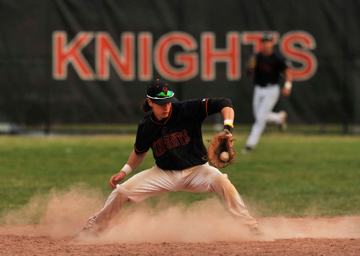 Stamford shortstop Travis Docimo fields a ball during the Black Knights' game against Greenwich at Stamford High School on Wednesday, April 10, 2013. Greenwich beat Stamford, 10-4 in 8 innings.