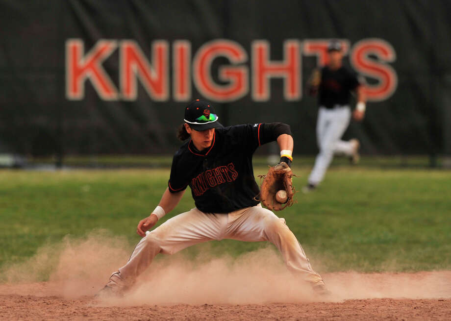 Stamford shortstop Travis Docimo fields a ball during the Black Knights' game against Greenwich at Stamford High School on Wednesday, April 10, 2013. Greenwich beat Stamford, 10-4 in 8 innings. Photo: Jason Rearick / Stamford Advocate