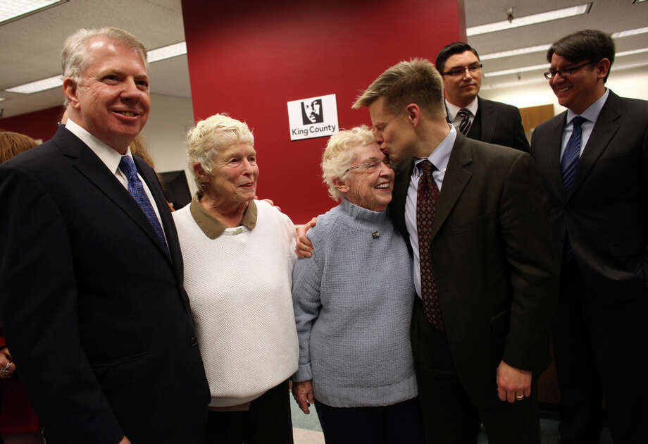 From left, Senator Ed Murray, Jane Abbott Lightly, her partner Pete-e Petersen and Rep. Jamie Petersen celebrate as gay couples wait for marriage licenses at the King County Administration Building. Photo: JOSHUA TRUJILLO, SEATTLEPI.COM / SEATTLEPI.COM