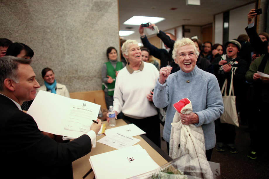 Jane Abbott Lightly and her partner Pete-e Petersen, right, celebrate as King County Executive Dow Constantine signs their marriage license. Photo: JOSHUA TRUJILLO, SEATTLEPI.COM / SEATTLEPI.COM
