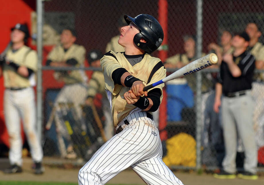 Jonathan Law's Rob Griswold gets a hit, during baseball action against Foran in Milford, Conn. on Wednesday April 10, 2013. Photo: Christian Abraham / Connecticut Post