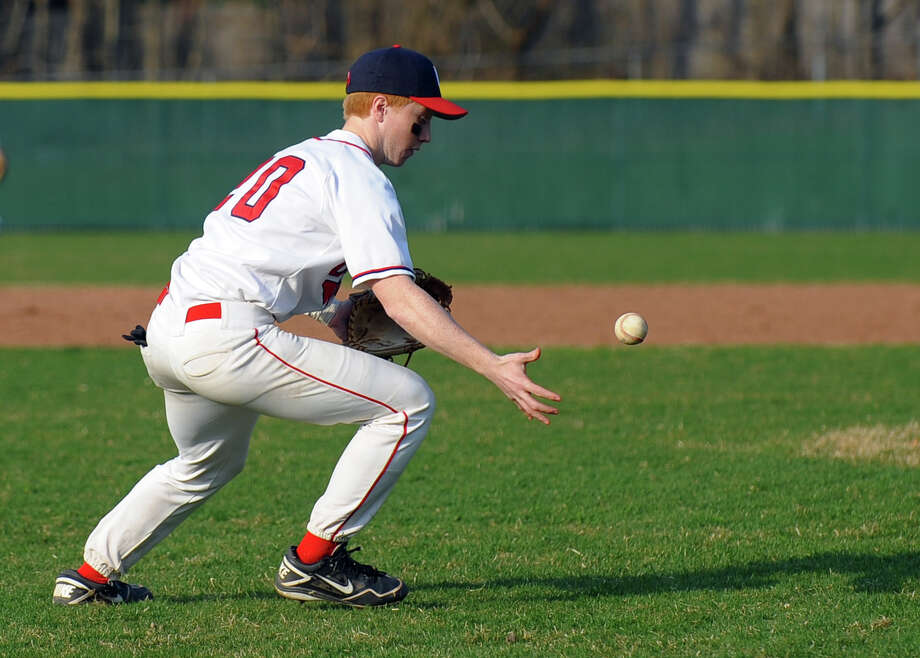 Foran's third baseman San Olsson fields a Jonathan Law grounder, during baseball action in Milford, Conn. on Wednesday April 10, 2013. Photo: Christian Abraham / Connecticut Post