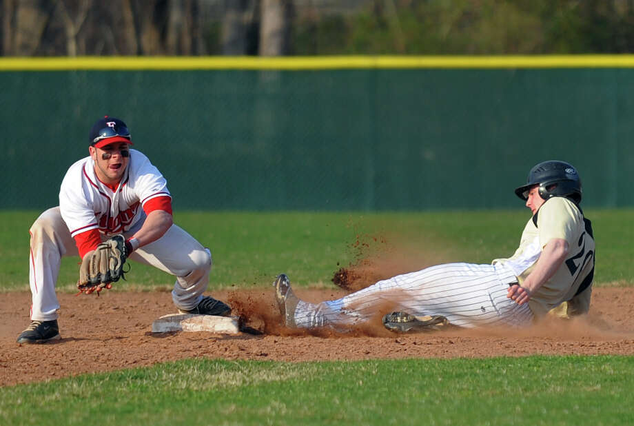 Foran's Gabe Ciccaglione tags out a Jonathan Law player, during baseball action in Milford, Conn. on Wednesday April 10, 2013. Photo: Christian Abraham / Connecticut Post