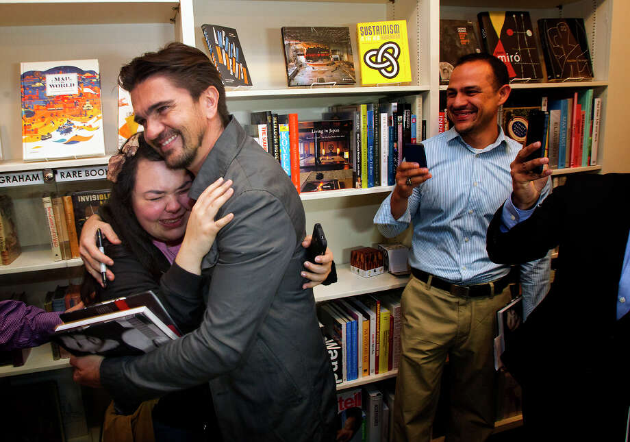 Colombian pop star Juanes, hugs fan Marina Garcia, at the Brazos Book Store, Wednesday, April 10, 2013, in Houston. Photo: Cody Duty, Houston Chronicle / © 2013 Houston Chronicle