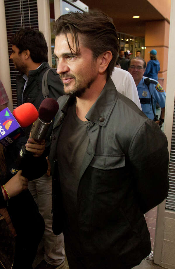 Colombian pop star Juanes stopped by the Brazos Book Store to promote his book, Wednesday, April 10, 2013, in Houston. Photo: Cody Duty, Houston Chronicle / © 2013 Houston Chronicle