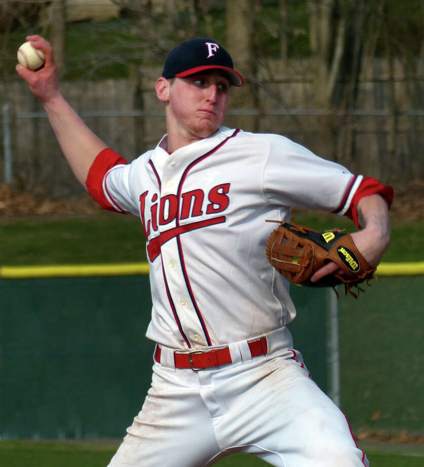 Foran's Casey McCone pitches against Janathan Law, during baseball action in Milford, Conn. on  April 10, 2013. Photo: Christian Abraham / Connecticut Post
