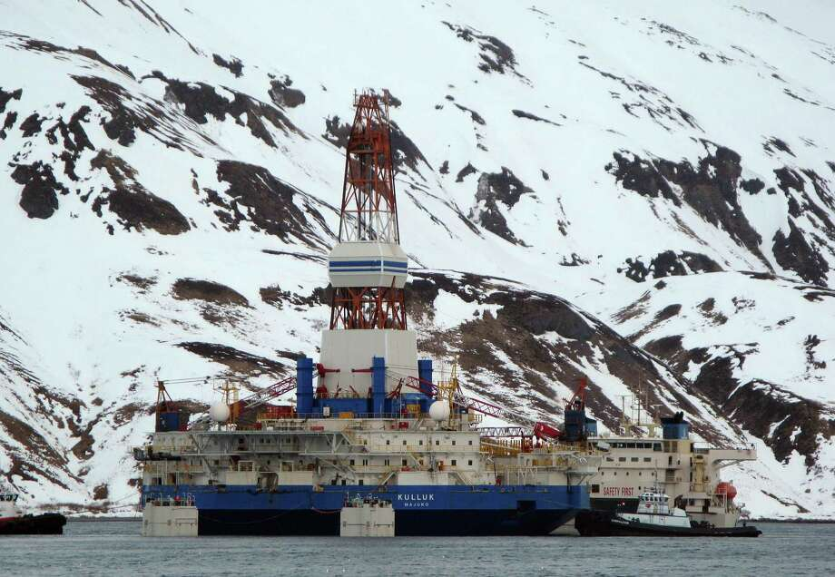 Drilling in the Arctic sometimes leads to setbacks such as what happened when a storm damaged the Royal Shell Dutch drilling barge, Kulluk, while it was under tow in open waters. Photo: Jim Paulin / Associated Press