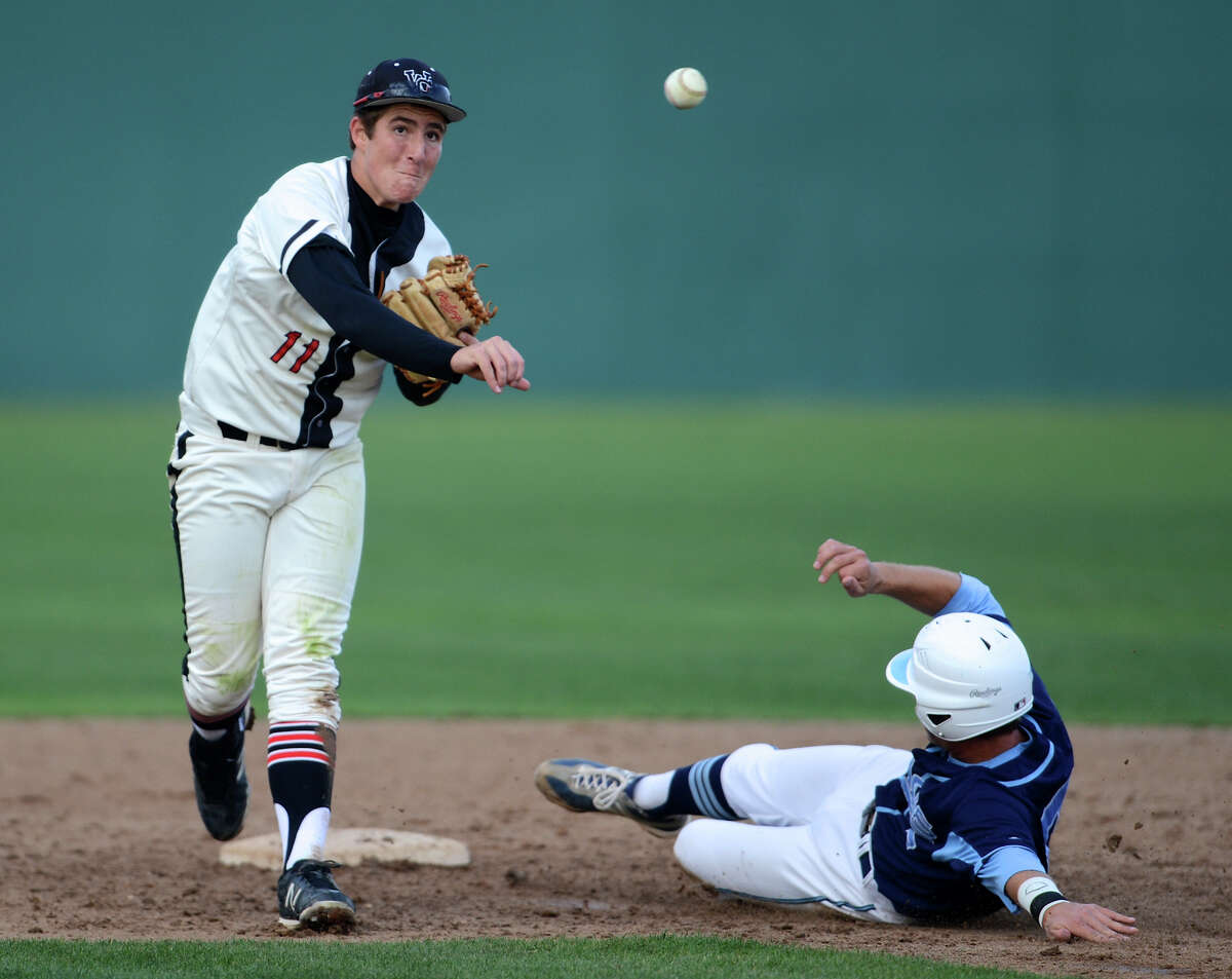 Churchill shortstop Jake Kirksey turns a double play in the Chargers' 15-3 run-rule victory over Johnson on Wednesday.
