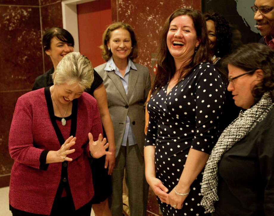 Mayor Annise Parker, left, and Gwendolyn Zepeda celebrate the announcement of the city's first poet laureate at City Hall on Wednesday. Photo: Brett Coomer, Staff / © 2013 Houston Chronicle