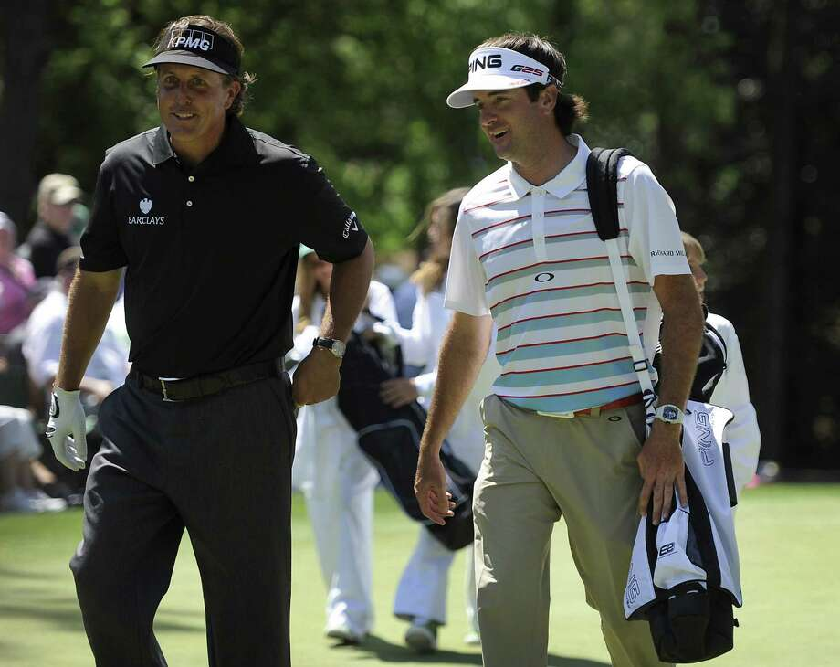 Phil Mickelson (left) and defending champion Bubba Watson stroll during the Par 3 contest. Watson aced No. 16 during his practice round. Photo: Jeff Siner / McClatchy-Tribune News Service