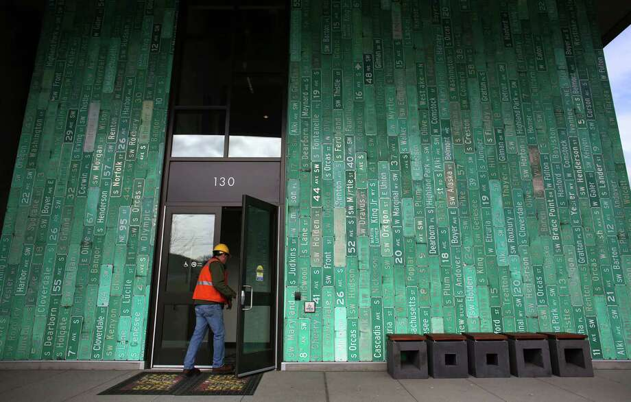 A worker walks through the front entrance of the South Transfer. The entrance is covered with retired street signs. Photo: JOSHUA TRUJILLO, SEATTLEPI.COM / SEATTLEPI.COM