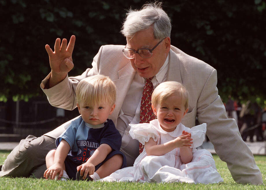 FILE- The British pioneer of IVF treatment, Professor Robert Edwards sits with two of his 'test-tube-babies', Sophie and Jack Emery who celebrate their second birthday in London in this file photo dated Monday July 20, 1998. The Nobel prize winner for medicine,  Edwards who was a pioneer of in-vitro fertilization, which became known as test tube babies, has died aged 87, it is announced Wednesday April 10, 2013. (AP Photo/Alastair Grant, File) Photo: ALASTAIR GRANT