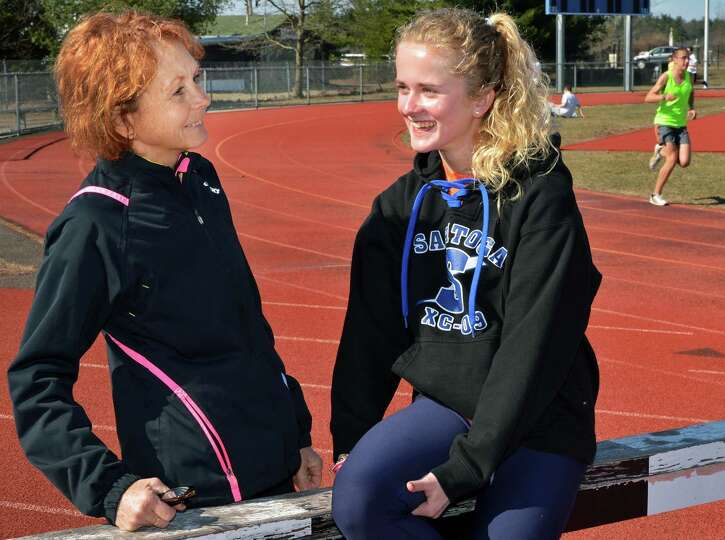 Keelin Hollowood, at right, with coach Linda Kranick during practice on the main track at Saratoga S