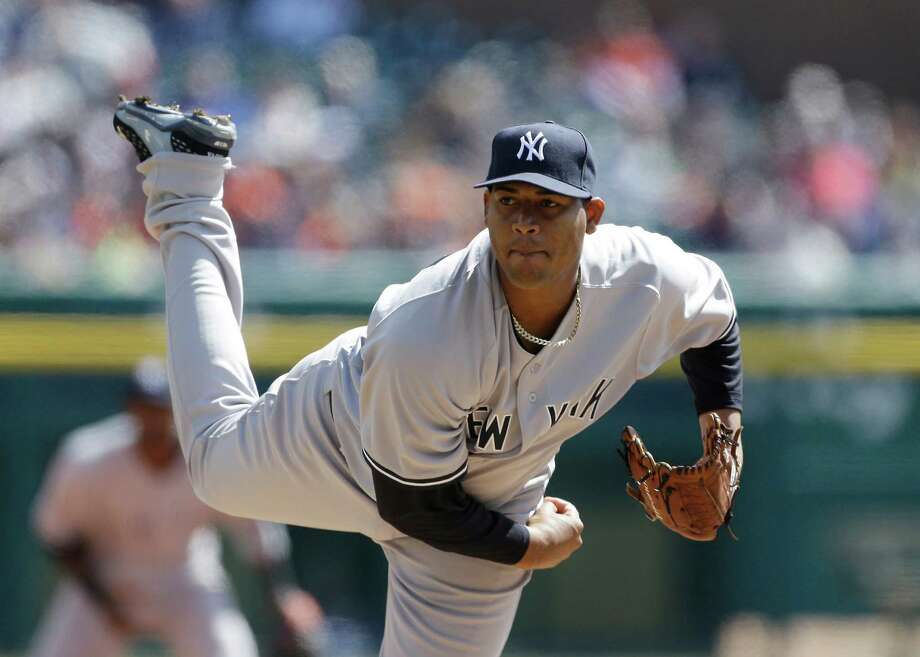New York Yankees starting pitcher Ivan Nova throws during the first inning of a baseball game against the Detroit Tigers in Detroit, Friday, April 5, 2013. (AP Photo/Carlos Osorio) Photo: Carlos Osorio / AP