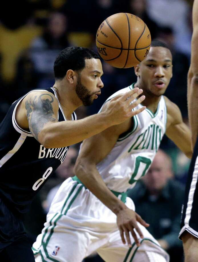 Brooklyn Nets point guard Deron Williams (8) controls the ball as Boston Celtics guard Avery Bradley (0) defends during the first quarter of an NBA basketball game in Boston, Wednesday, April 10, 2013. (AP Photo/Elise Amendola) Photo: Elise Amendola