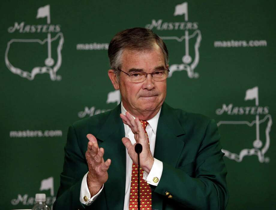 Billy Payne, chairman of Augusta National Golf Club, applauds during a media conference before the Masters golf tournament Wednesday, April 10, 2013, in Augusta, Ga. (AP Photo/Morry Gash) Photo: Morry Gash