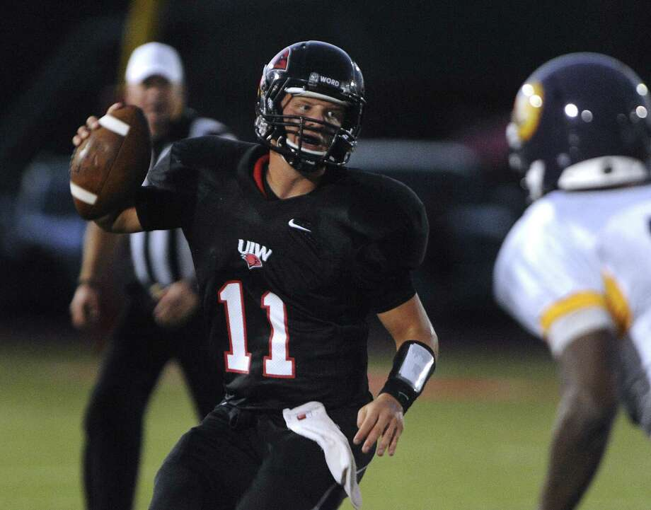 Trent Brittain, scrambling against Texas College last season at Benson Stadium, is battling Taylor Woods this spring for UIW's starting quarterback job. Photo: Billy Calzada / San Antonio Express-News