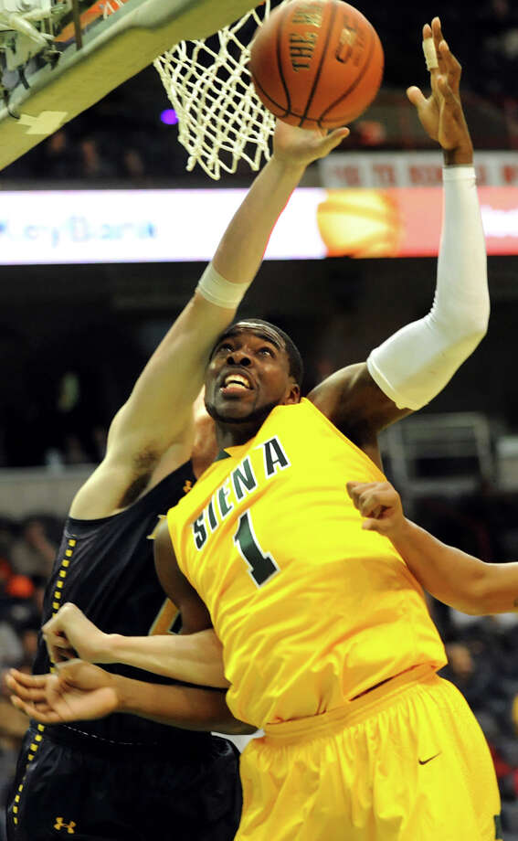 Siena's O.D. Anosike (1), center, fights for a rebound against LaSalle's Steve Zack (0) during their basketball game on Saturday, Dec. 29, 2012, at Times Union Center in Albany, N.Y. (Cindy Schultz / Times Union) Photo: Cindy Schultz / 00020599A