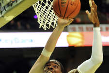Siena's O.D. Anosike (1), center, fights for a rebound against LaSalle's Steve Zack (0) during their basketball game on Saturday, Dec. 29, 2012, at Times Union Center in Albany, N.Y. (Cindy Schultz / Times Union)